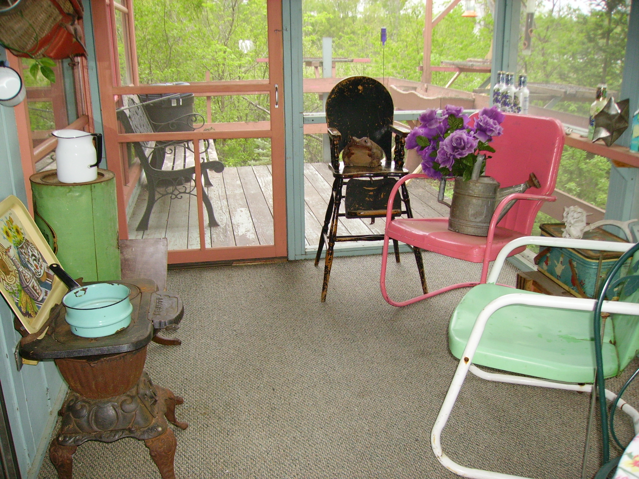 Stove and view of deck from retreat center