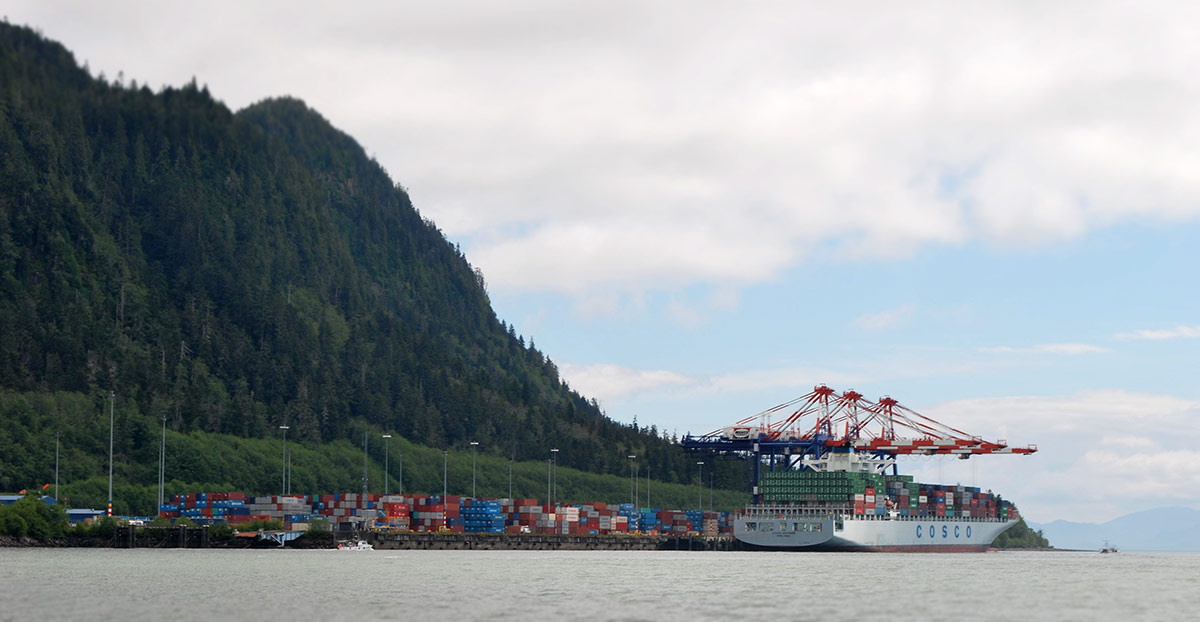 A container ship sits at rest at the container terminal in Prince Rupert.