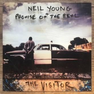 Our review of 'Visitor' by Neil Young + Promise