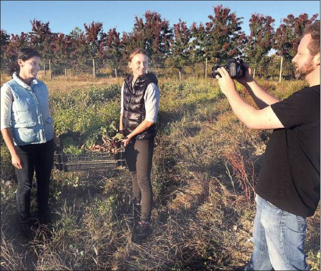 Photo by Paul Squire | Brent Sterling Nemetz (right) of Greenport is shooting the pilot for what he hopes will become a reality television series about Erin Fitzpatrick (left) and Lucy Muellner, owners of the Fork & Anchor general store in East Marion.