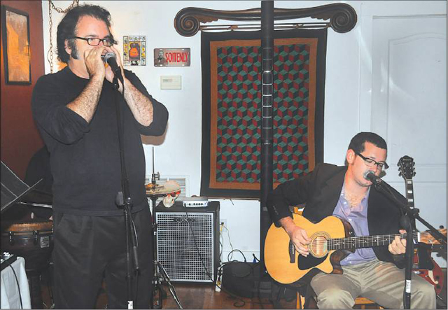 Photo by Cyndi Murray | Performers Chris Hurley (left) and Rob Europe are regulars at MEET's open mic night.