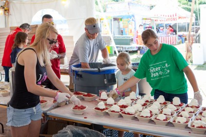 Volunteers working in the strawberry shortcake tent. (Credit: Northforker file photo)