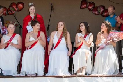 2015 Strawberry Queen Caroline Keil (standing), announces Joy Davis (center) as the winner. From left: Kathryn Jernick, 16, of Southold; Ashley Hilary, 15, of Southold; Joy Davis, 16, of Mattituck; Caitlyn Macomber, 17, of Greenport; Katie Stumpf, 17, of Mattituck.
