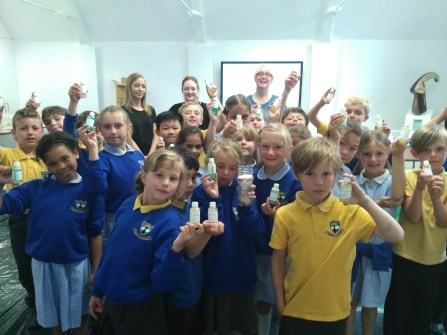 Children from Whitehill School with the bubble bath they made in a science project here