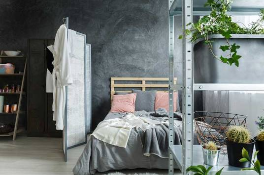 A open bachelor pad and loft bedroom nicely decorated