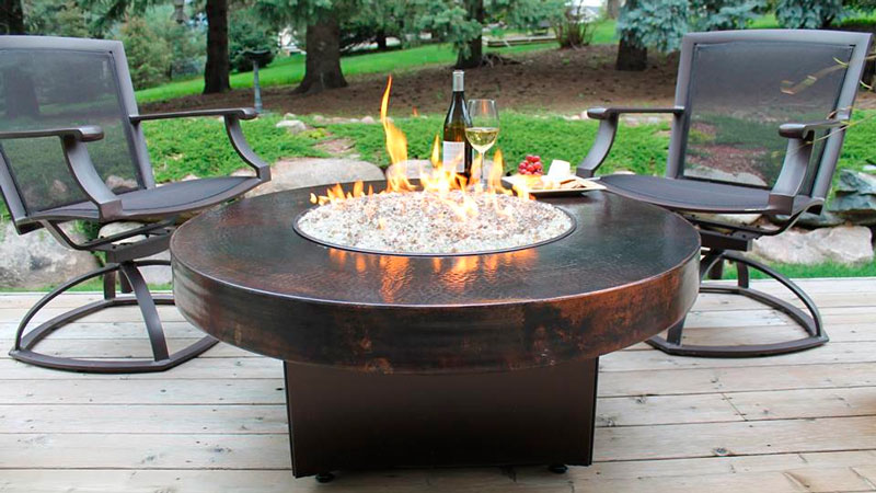 How should a fire pit be positioned