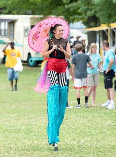 Arkansas circus woman walking on stilts