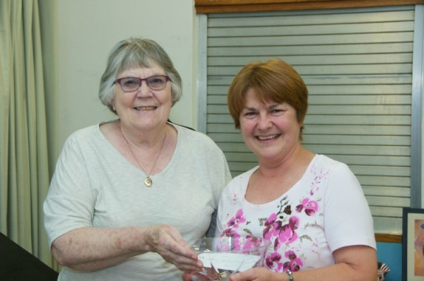Alicia CLyant presenting bowl to Jeanette Holdstock