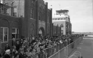 A crowd gathers to celebrate the new control tower at the terminal at the American Legion Municipal Airport in October 1941.