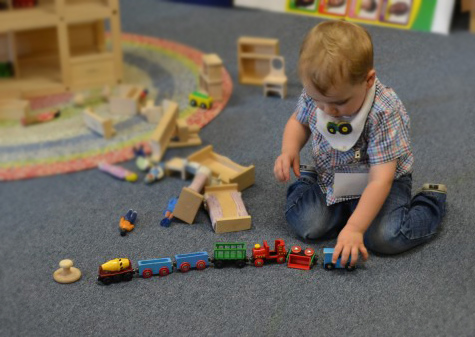 child plays with trains