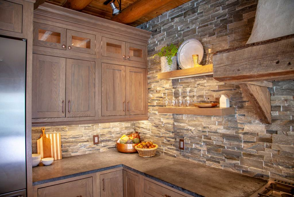 ledge stone backsplash, oak shelves, and soapstone counters