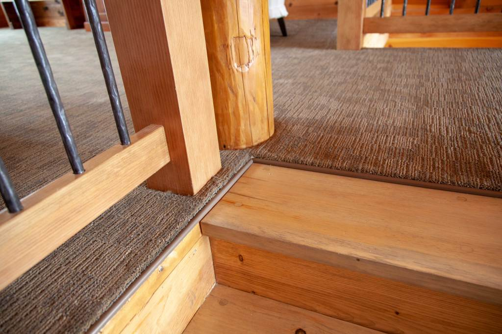 perfect carpet installation and seamless transition between custom staircase and carpeted loft.