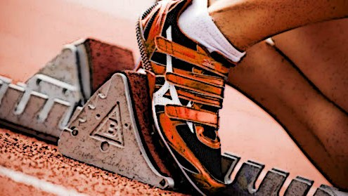 close up of a foot on a starting block