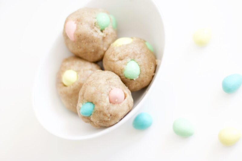 These easy no-bake cookie dough balls are filled with Cadbury Mini Eggs, a perfect Easter snack or dessert that's gluten-free and the batter is eggless and vegan. Only a few ingredients! | Snacks | Desserts | Easy recipes | Easter | Toddler Activities | No Bake | Sugar Cookies | Sugar Cookie Balls | Easter Eggs | Holiday Food | Special Occasion | Toddler Food | Baby Food | Kid-Friendly | Kid Friendly | Kids | Children | Activities | Edible Dough | Pastel colours | Chocolate |