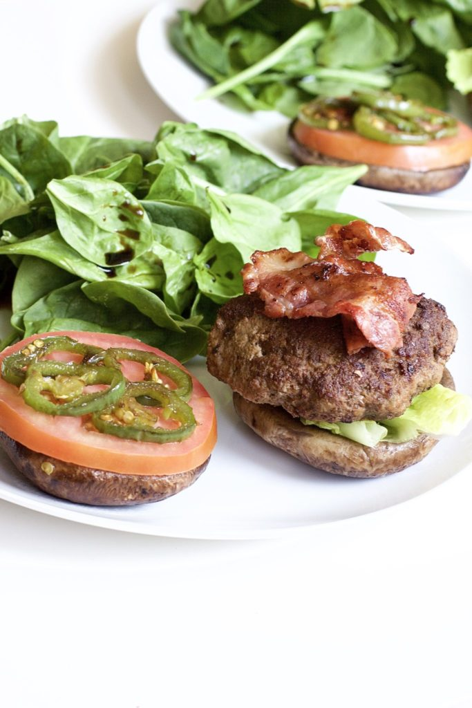 Portobello Mushroom Bacon Burgers are extremely juicy, delicious, and healthy. The ultimate paleo meal that's low carb, keto friendly and high in protein. Gluten Free | No Bread | Homemade Burgers | Gluten-Free Burgers | Keto Burgers | Homemade Hamburgers | Weight Loss | Dinner | BBQ Recipe | Grilling | Grilled Burgers | Bacon Burgers | Paleo | Whole 30 | Sugar Free Ketchup | Bun Replacement | Bread Replacement | Mushrooms |