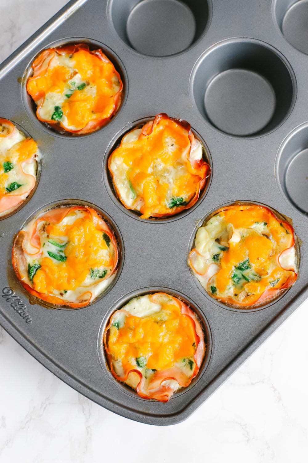 Keto and low carb egg cups are easy to prepare and great for a quick, on-the-go breakfast. Store in the fridge or freezer, reheat, and enjoy. Keto Breakfast Recipes   Low Carb Recipe   Egg Whites   Ham and Egg Cups   Easy Recipes   Fat Burn   Weight Loss   Low Calorie   Gluten-Free   Sugar Free   Whole 30   Paleo   Kid-Friendly   Quick and Easy  