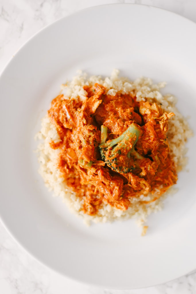 Homemade Slow Cooker Butter Chicken on top of cauliflower rice is sugar free, grain free, dairy free, and low carb. Powerful ingredients for optimal health and weight loss. Keto Butter Chicken | Dinner | Entrees | Slow Cooker | Crock Pot | Indian Cuisine | Healthy | Weight Loss | Ketogenic | Gluten-Free | Whole 30 | Paleo | Kid Friendly | Homemade | Butter Chicken Sauce | Family Dinner | Easy Slow Cooker Recipe | Broccoli and Chicken | Entree Dish |