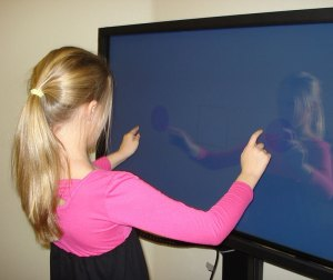 Ryleigh improves her eye-hand coordination with the Sanet Vision Integrator's touchscreen.