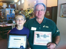 Austin receiving an award from Paradise Depot Museum Curator Tim McGrath.