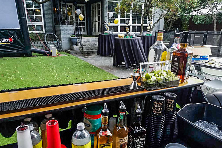 north texas wedding and event service bar setup in a backyard
