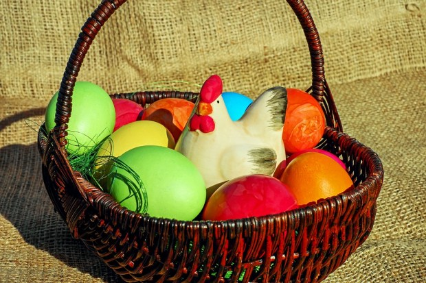 Easter eggs in a basket with a hen graphic for Easter