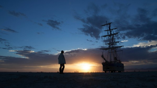 Woman and ship silhouette at sunrise at Burning Man 2012 on northtosouth.us
