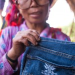 custom embroidered jeans by the Red Dao women of Sapa, Vietnam