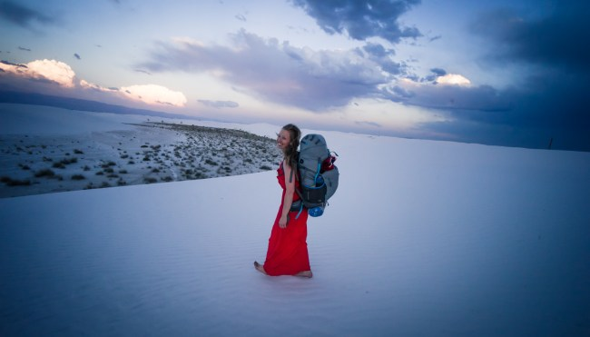 Backpacking in a red dress at White Sands National Monument
