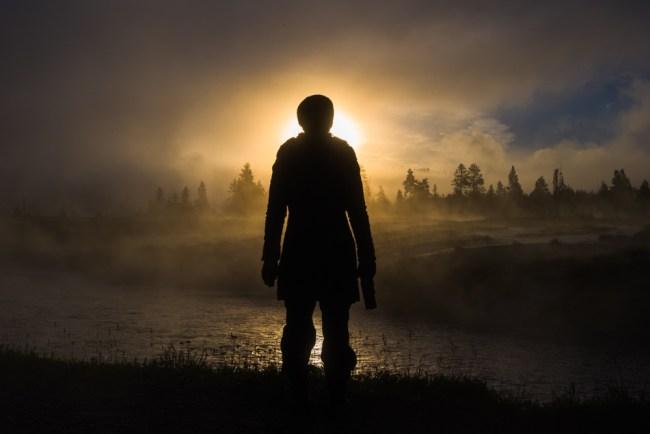 Yellowstone foggy sunrise silhouette