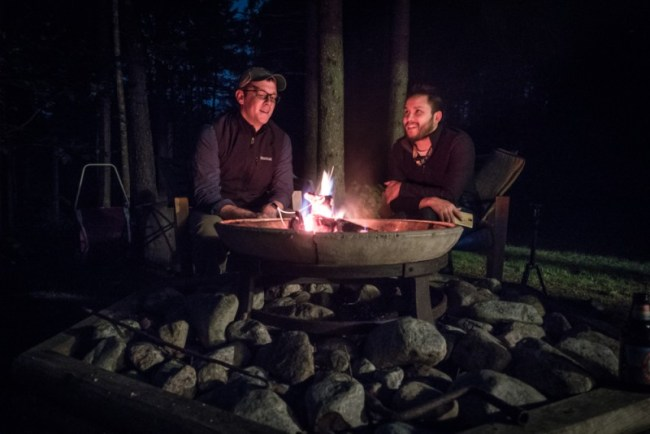 Ian and Tim chatting by the fire in the Adirondacks