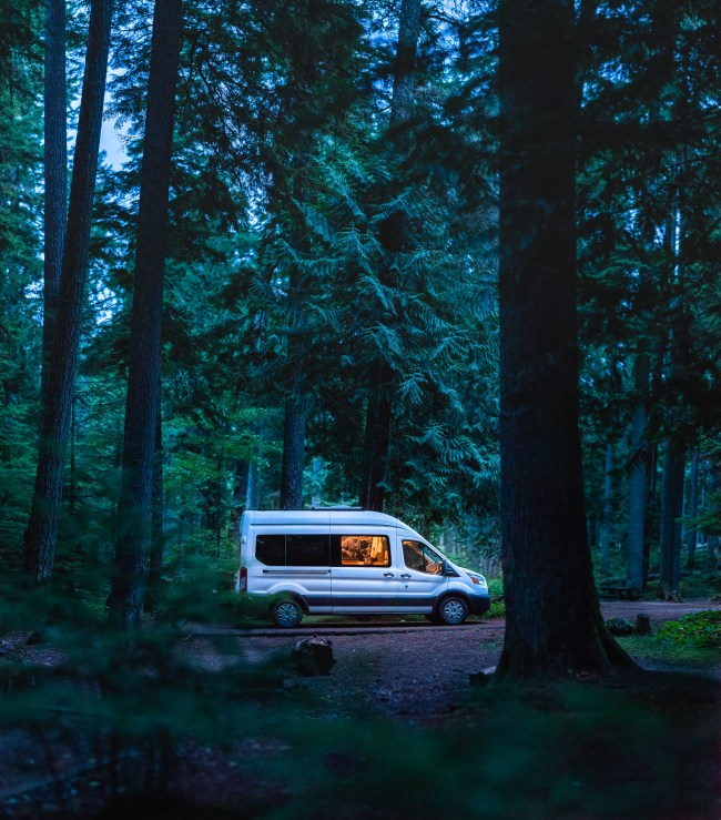 Cozy Ford Transit Campervan in the forest at Silver Springs Campground, Washington