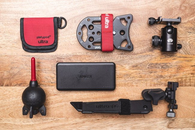 Platypod Ultra and its spiked feet case, a Sirui C-10 Ballhead, Giottos Rocket Blaster, Anker Powercore II Slim USB Battery, and Pedco Ultrapod II
