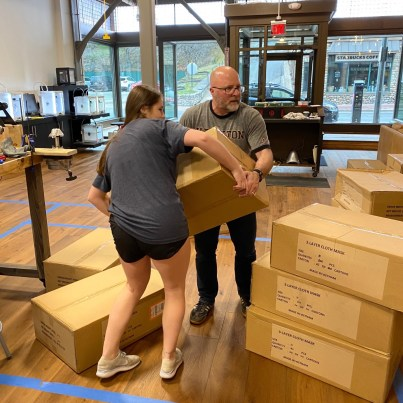 Kate Broderick '22 and Mr. Tom Broderick organize the shipment of masks at the Innovation Hub on Main Street. (Photo provided)
