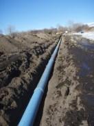 Installing irrigation pipeline on Cowiche Creek