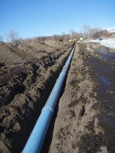 Installing irrigation pipeline on Cowiche Creek