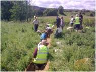 North York Moors Conservation Volunteers - putting in silt traps and geotextile to hold back sediment in a drainage ditch.