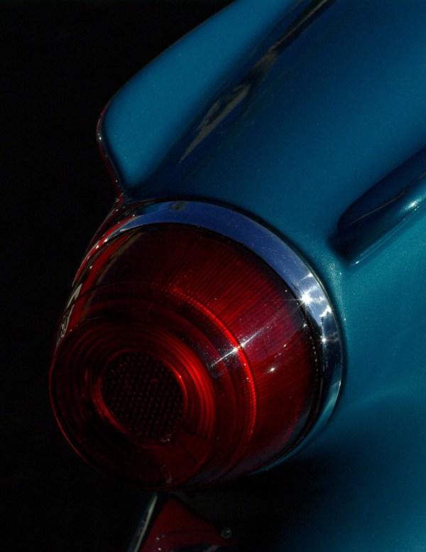 closeup photo of stylized Corvette blinker titled 54 Vette by Michael Rubin