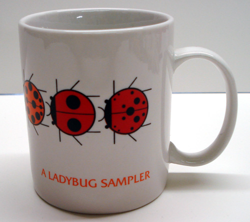 Charley Harper Ladybug Sampler mug on white background