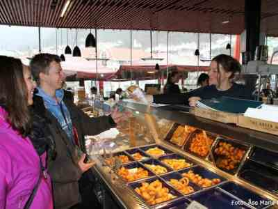 Enjoying local food at the fishmarket in Bergen, Norway