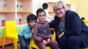 Minister Elisabeth Aspaker along with two of the children at the new preschool.