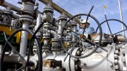 A worker checks the valves at Al-Sheiba oil refinery in the city of Basra, Iraq