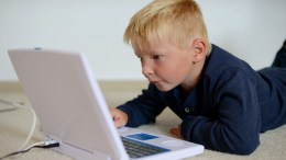 Boy is playing with a computer