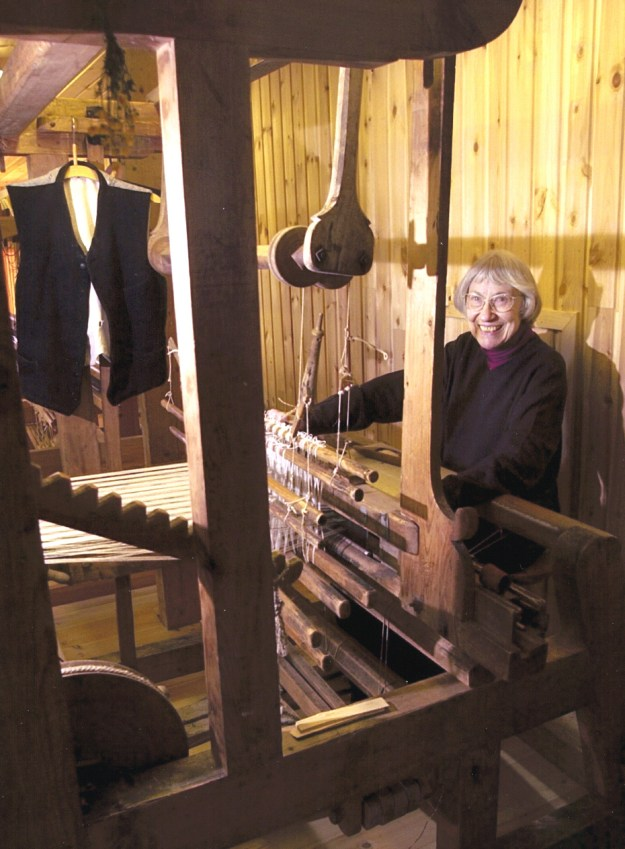 Lila weaving at an historic loom that belongs to Eli Vesaas; at Vesaas Farm weaving studio, Vinje, Telemark, Norway, 2002.