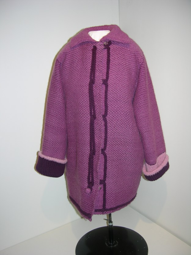 Weaving was added to the National Exhibition, an annual judged exhibition of folk art in the Norwegian tradition, in 1981. A jacket woven by Marie Nodland of St. Paul, Minnesota, won a blue ribbon that year. The diamond twill reverses to rya (pile weave) and there are handknit collar and cuffs.