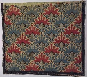 One of several old Norwegian skybragd weavings in the Norwegian Digital Museum, at: https://digitaltmuseum.no/011023238942/putetrekk