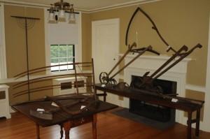 display of antique farm tools