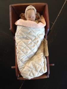 Miniature coll and cradle by Dewees Cochran. Gift of Rose Bender.