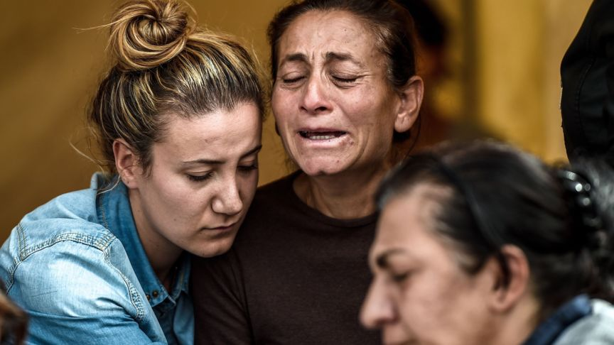 Three women wait at the Ankara mortuary for the dead bodies of victims