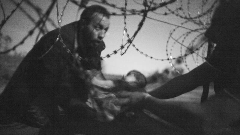Refugees at Hungarian border, photo by Warren Richardson