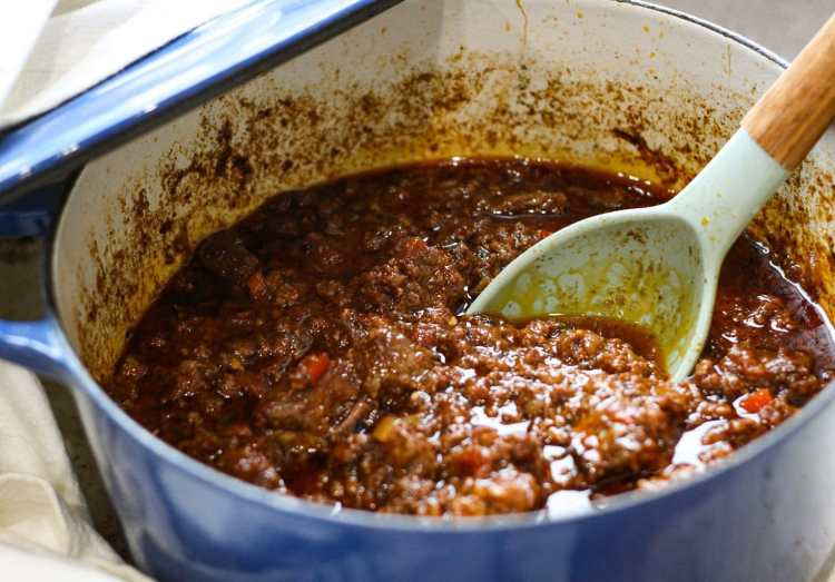 chili con carne in a blue pot